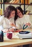 Two pretty women doing handmade blue beads Stock Photography