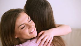 Two pretty women embracing, close friends hugging, laughing having fun. Pretty teenage girl laughing, hugging best friend, two young women embracing, spending stock video footage