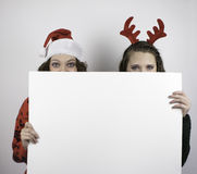 Two pretty women holding blank sign Royalty Free Stock Image