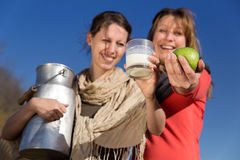 Two pretty women present healthy bio food Stock Photography