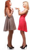 Two pretty women ginger with blonde in gowns on white Royalty Free Stock Photos
