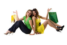 Two pretty women sits with bags Royalty Free Stock Photos