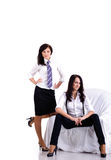 Two pretty young businesswomen Stock Photos