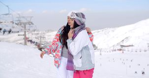 Two pretty young female friends at a ski resort stock video