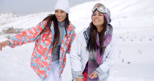 Two pretty young female friends at a ski resort Royalty Free Stock Photos