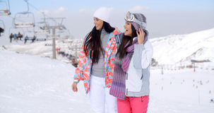Two pretty young female friends at a ski resort Stock Photos