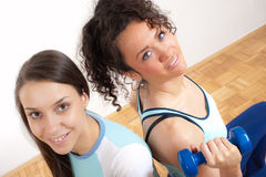 Two pretty, young fitness girls with weights Royalty Free Stock Image