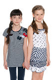 Two pretty young girls against the white Royalty Free Stock Images