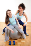 Two pretty young girls fitness exercising Royalty Free Stock Images