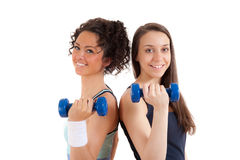 Two pretty, young girls fitness with weights Stock Photos
