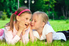 Two pretty young girls on a grass Royalty Free Stock Photos
