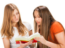 Two pretty young student girls Stock Images
