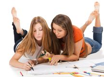 Two pretty young student girls Royalty Free Stock Photos