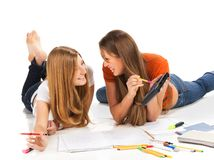 Two pretty young student girls Stock Photos