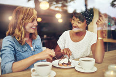 Two pretty young woman enjoying coffee Stock Photography