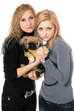 Two pretty young women with pekingese Royalty Free Stock Photo
