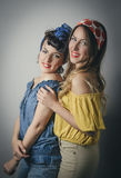 Two pretty young women in retro clothing Royalty Free Stock Image