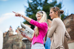 Two pretty, young women sightseeing in Prague Royalty Free Stock Photos