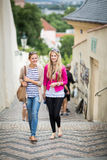 Two pretty, young women walking in the Prague Royalty Free Stock Image