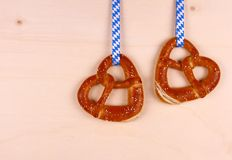 Two pretzel in heart shape on wood background Stock Images