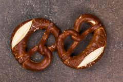Two Pretzel lying on the board Stock Image