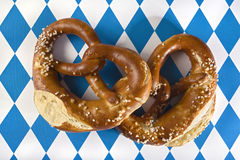 Two pretzels on bavarian flag background Stock Photos
