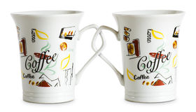 Two for the price of one cups. Two for the price of one cups, concept on coffe cops with interlocked handles Royalty Free Stock Images