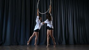 Two professional acrobats performs a trick on the aerial hoop stock footage