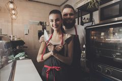 Two professional bakers are standing near oven. royalty free stock photos