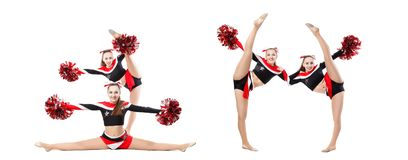 Two professional cheerleaders with pompoms posing at studio. Vertical split. Isolated over white. girl dancer practicing mixed. Dance and stretching, extending stock photos