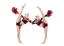 Two professional cheerleaders posing at studio. Vertical split. Royalty Free Stock Photos