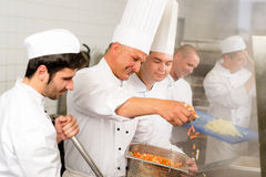 Two professional chefs cooking in kitchen. Professional kitchen happy chef prepare food meal international cuisine stock image