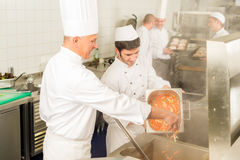 Two professional chefs cooking in kitchen stock photos