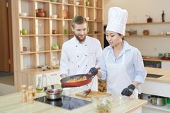 Two Professional Chefs at Work stock photo