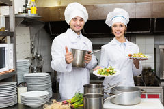 Two professional cookes working Stock Image
