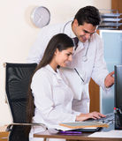 Two professional doctors brainstorming and sharing information Stock Image