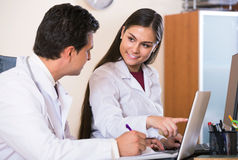 Two professional doctors brainstorming and sharing information Stock Photos