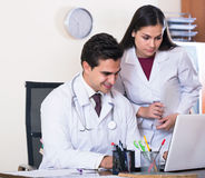 Two professional doctors brainstorming and sharing information Stock Photo