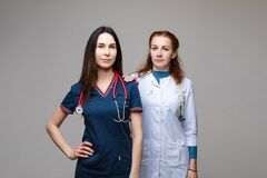 Two professional doctors with stethoscopes. together fighting against COVID-19 or coronavirus.