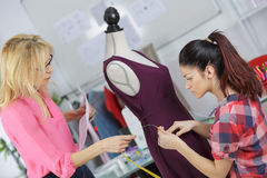 Two professional dressmakers working on dress Royalty Free Stock Photo