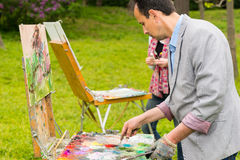 Two professional fashionable creative painters during an art cla Royalty Free Stock Photo