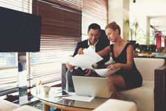 Two professional managers are working together with paper documents Stock Photos