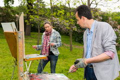 Two professional painters working in the open air Stock Photography