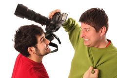 Two Professional photographers fighting Stock Image