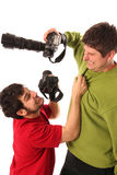 Two Professional photographers fighting royalty free stock image