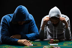Two professional poker players sitting at a table Stock Images