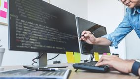 Two professional programmers cooperating at Developing programming and website working in a software develop company office, writ royalty free stock images
