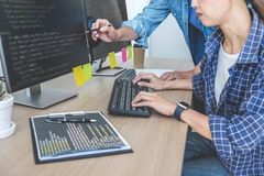 Two professional programmers cooperating at Developing programming and website working in a software develop company office,. Writing codes and typing data code royalty free stock photography