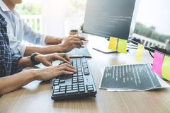 Two professional programmers cooperating at Developing programming and website working in a software develop company office,. Writing codes and typing data code stock images