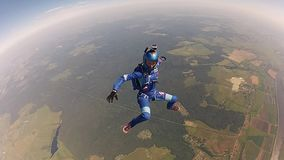 Two professional skydivers jump from airplane fall in sky. Speed. Hold balance. stock footage